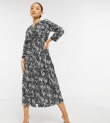 Vero Moda Petite wrap midi dress with tie waist in black and white spl...